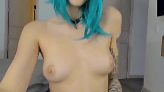 Blue haired alternative babe getting topless