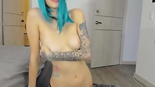 Blue haired slut getting naked